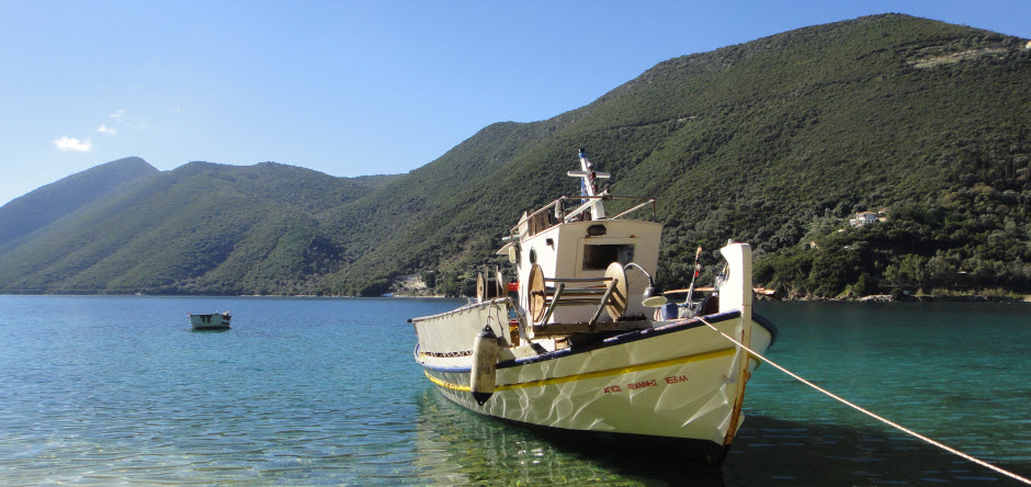 Desimi Bay and one of the traditional greek boats